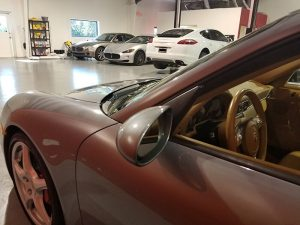 An image of 2 Porsche and 2 Maserati at Active Euroworks auto repair shop