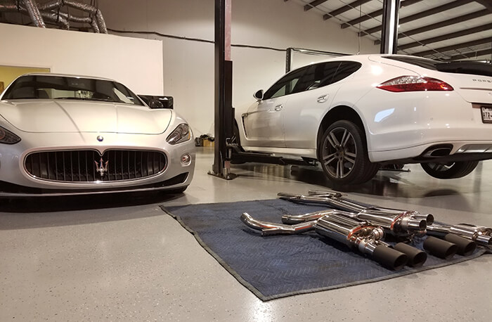 Image with a Maserati and a Porsche and various exhaust pieces