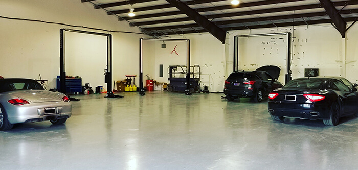 A Porsche and Aston Martin at the tidy Active Euroworks repair shop