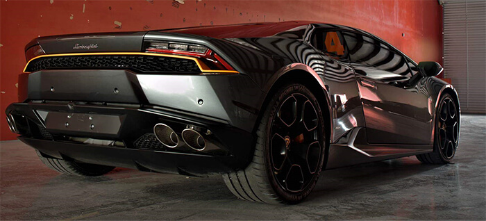 Rear-end image taken of a Lamborghini with gray paintwork